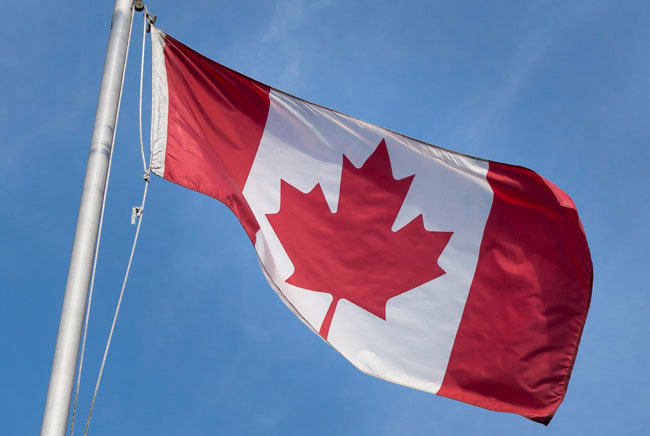 Canada's flag raised on a flagpole