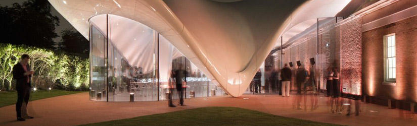 Serpentine Sackler Gallery with a curved, white roof and a massive window front